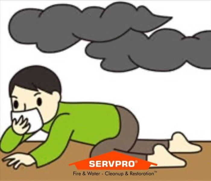 Cartoon of a boy with green shirt and brown pants crawling on the floor while 2 black clouds are above him