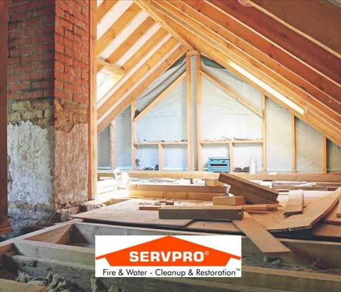 a photo of the inside of an attic and the SERVPRO logo at the bottom