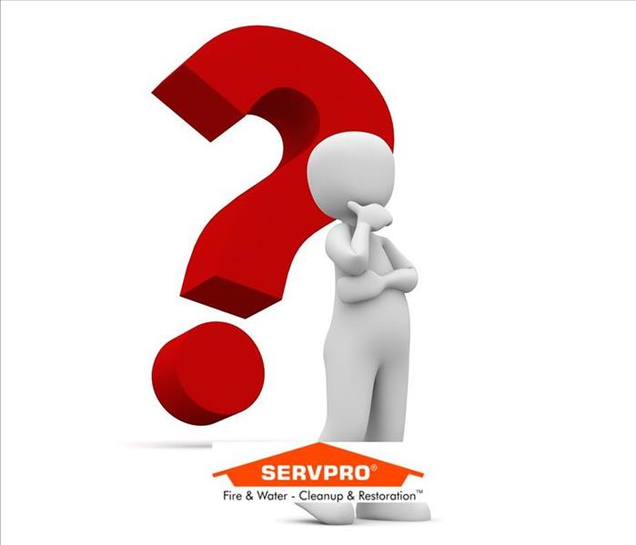 A clip art image of a person leaning on a big red question mark and the SERVPRO logo